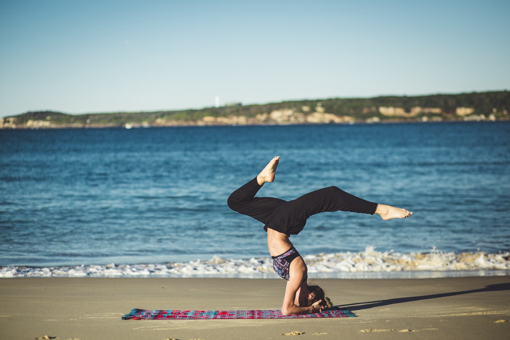 woman doing yoga beside the seashore - victoria secret yoga pants